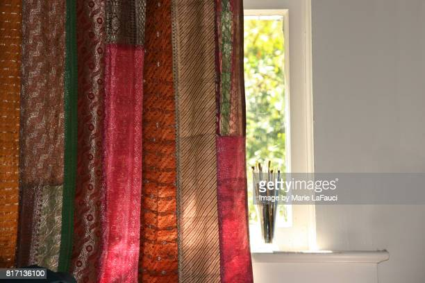 Handmade colorful textile curtain and window sill