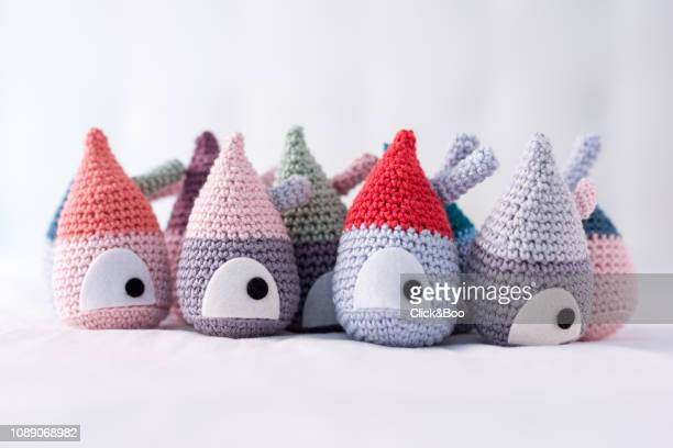 Handmade crocheted doll's houses on a row (different colors)