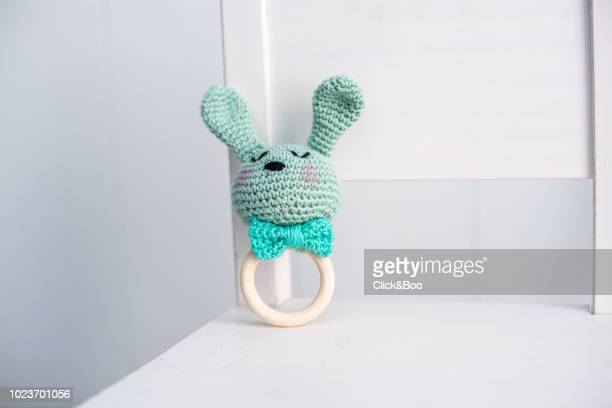 handmade crocheted rabbit rattle with a bow tie - toy rattle stock pictures, royalty-free photos & images