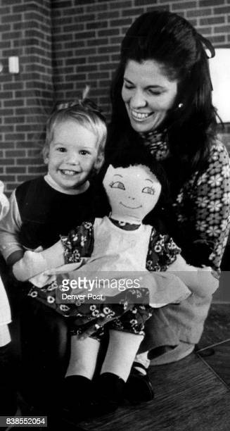 A handmade doll brings smiles to Mrs Peter Coors and daughter Melissa The doll will be for sale at the Golden Rose Boutique sponsored by Spalding...