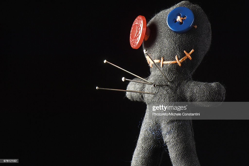 Handmade doll used as pin cushion or voodoo doll : Stock Photo