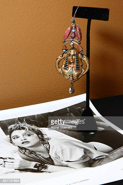 A handmade earring worn by singer Madonna and actress Rosanna Arquette in the 1985 film 'Desperately Seeking Susan' is displayed during Julien's...