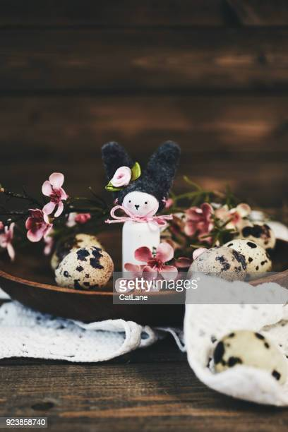 Handmade Easter bunny with blossoms and quail eggs