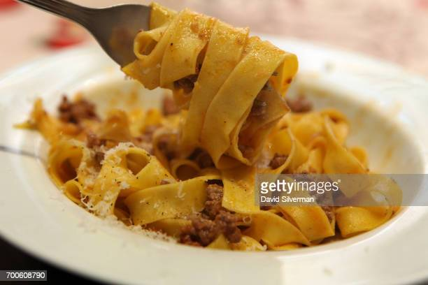 Handmade fettuccine is served with Bologna's iconic 'ragu' meat sauce after a cooking lesson at Il Salotto di Penelope on March 30 2017 in Bologna...