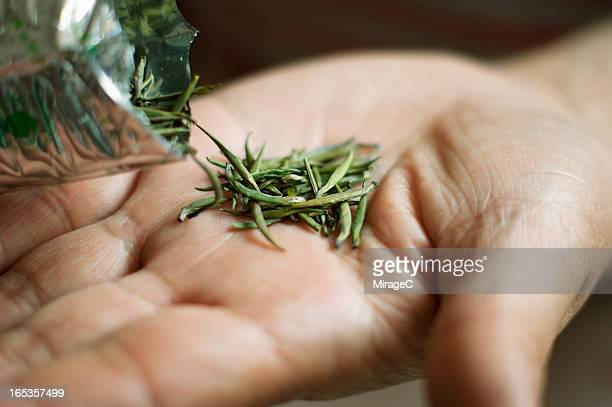 handmade green tea - tea leaves stock photos and pictures