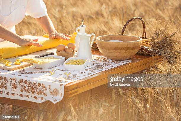 handmade italian pasta among wheat fileds