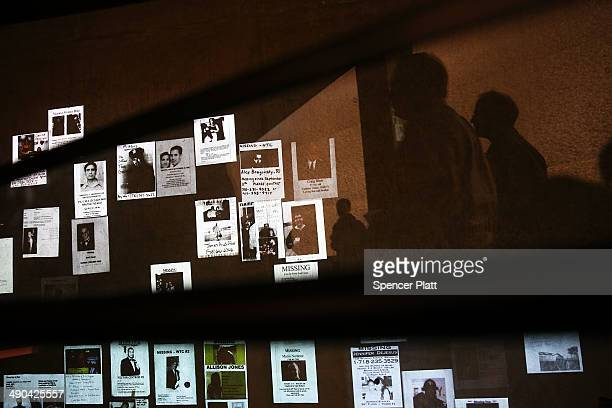 Handmade missing posters of victims of September 11 are viewed during a tour of the National September 11 Memorial Museum on May 14 2014 in New York...