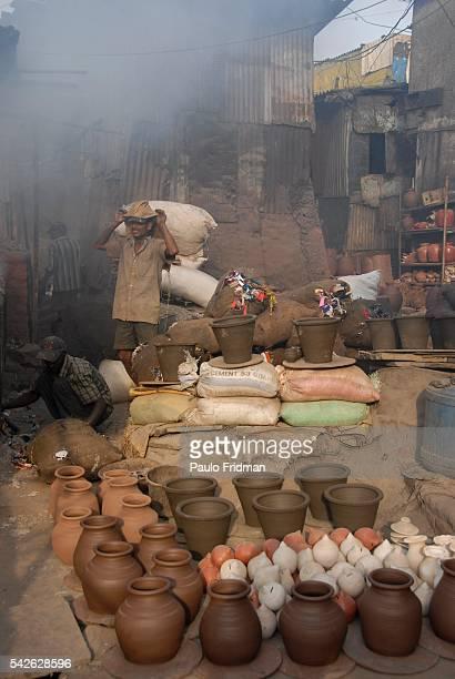 Handmade pots in Dharavi Asia's biggest slum in Mumbai Maharastra India
