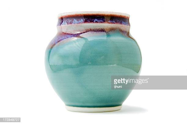 Handmade pottery vase on white