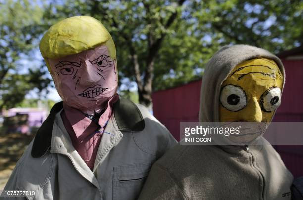 Handmade puppets of United States President Donald Trump and Homer Simpson made by a local craftsman are displayed ahead of New Year's Eve in Managua...
