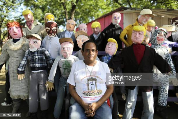 Handmade puppets of United States President Donald Trump and others made by a local craftsman are displayed ahead of New Year's Eve in Managua on...