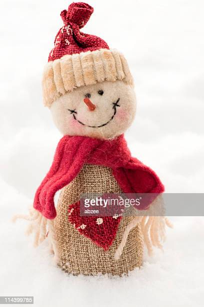 Handmade santa christmas decoration on real snow background