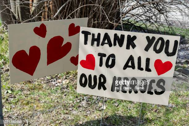 Handmade signs on a lawn says Thank You To All Our Heroes with hearts drawn on it On April 15 New York Governor Andrew Cuomo announced that he was...