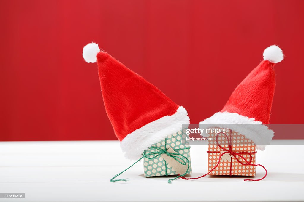 Handmade Small Gift Boxes With Santa Hats Stock Photo Getty Images