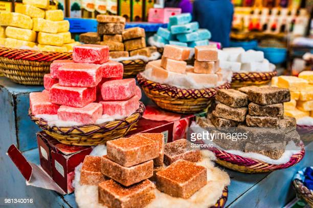 handmade soap on display in souks of morocco - souk stock pictures, royalty-free photos & images