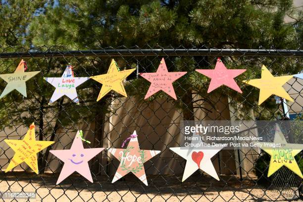 Handmade stars with encouraging messages of hope love and support hang on a fence at STEM School on August 5 2019 in Highlands Ranch Colorado Classes...