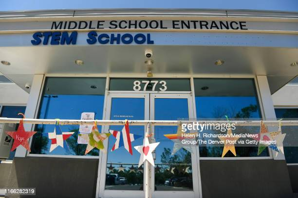Handmade stars with encouraging messages of hope, love and support hang outside of the middle school entrance at STEM School on August 5, 2019 in...