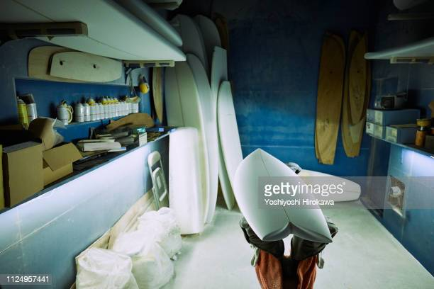 handmade surfboard in workshop - molding a shape stock pictures, royalty-free photos & images