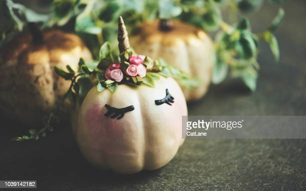 handmade unicorn pumpkin with foliage - unicorn stock pictures, royalty-free photos & images