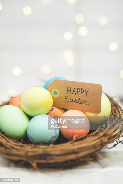 handmade woven easter basket of eggs - easter basket stock pictures, royalty-free photos & images
