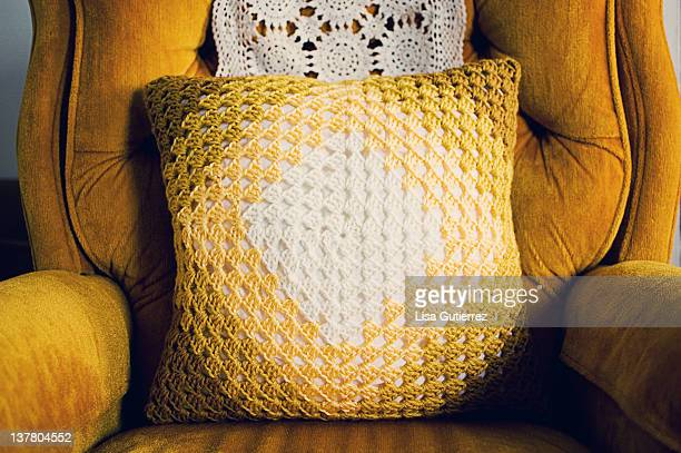 Handmade yellow granny square pillow