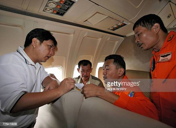 Handoko whose recently married son is one of the Adam air passengers and Fani Duran travel in a Boeing 737200 in the skies near Makassar 07 January...