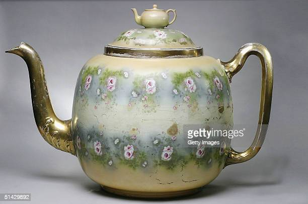 Handout image of an extraordinary teapot that is capable of holding some 1024 cups of tea and needs two strong men to lift it was sold by Bonhams on...
