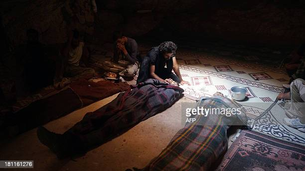 A handout image released by the Syrian opposition's Shaam News Network on September 19 2013 shows Syrian rebels mourning fallen comrades in the...