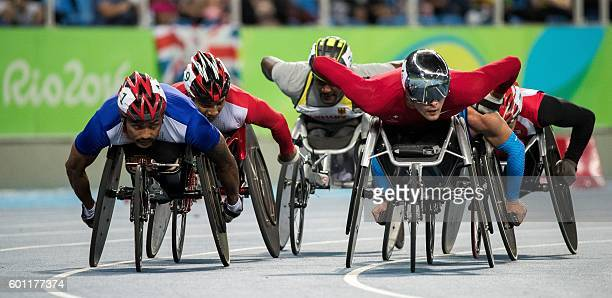 Handout image supplied by OIS/IOC showing Marcel Hug of Switzerland leading the men's 5000m T54 wheelchair race at the Olympic Stadium during the...