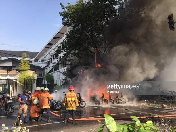A handout photo from the Government of Surabaya showing a bomb blast at Surabaya Pantekosta Center Church on May 13 2018 in Surabaya Indonesia At...