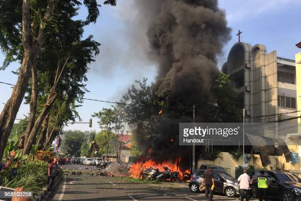 A handout photo from the Government of Surabaya showing a bomb blast at Surabaya Pantekosta Center Church on May 13 2018 in Surabaya Indonesia At...