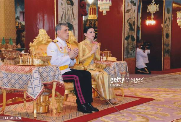 A handout photo from the Public Relations for the Coronation of King Rama X showing Thai King Maha Vajiralongkorn and his wife Suthida Vajiralongkorn...