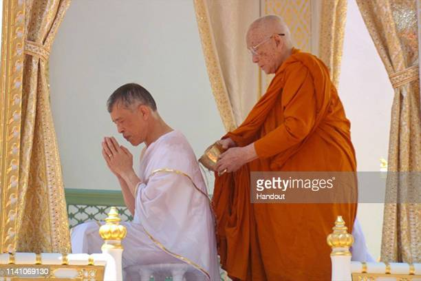 A handout photo from the Public Relations for the Coronation of King Rama X showing Thai King Maha Vajiralongkorn during the royal purification abbot...