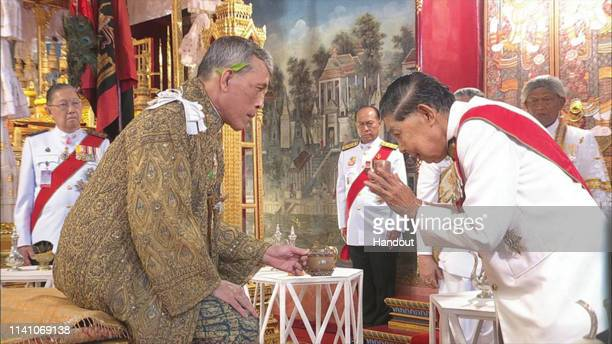 A handout photo from the Public Relations for the Coronation of King Rama X showing Thai King Maha Vajiralongkorn during the coronation ceremony at...