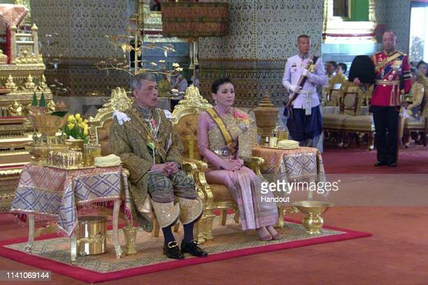 A handout photo from the Public Relations for the Coronation of King Rama X showing Thai King Maha Vajiralongkorn and his wife Queen Suthida during...