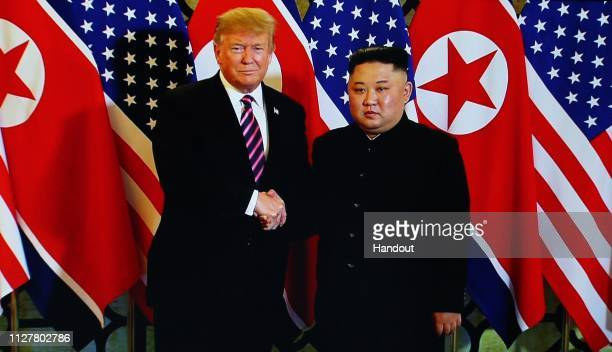 A handout photo of US President Donald Trump and North Korean leader Kim Jongun during their second summit meeting at the Sofitel Legend Metropole...