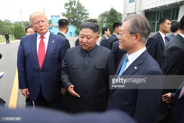 A handout photo provided by DongA Ilbo of North Korean leader Kim Jong Un US President Donald Trump and South Korean President Moon Jaein inside the...