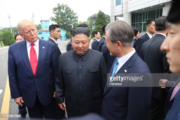 Handout photo provided by Dong-A Ilbo of North Korean leader Kim Jong Un, U.S. President Donald Trump, and South Korean President Moon Jae-in inside...