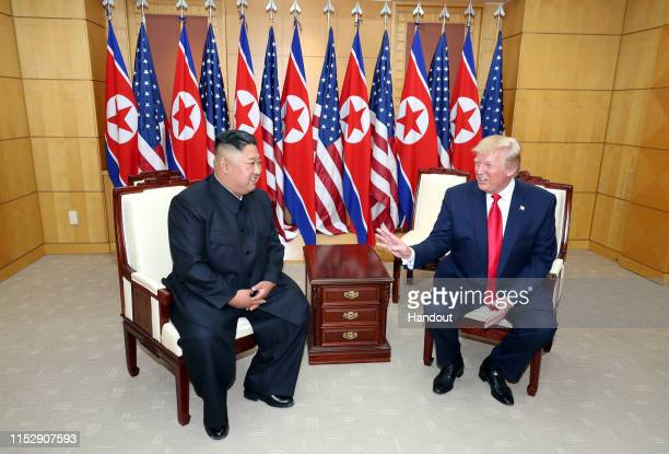 Handout photo provided by Dong-A Ilbo of North Korean leader Kim Jong Un and U.S. President Donald Trump attend a meeting on the south side of the...