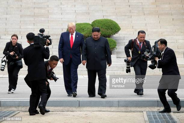 Handout photo provided by Dong-A Ilbo of North Korean leader Kim Jong Un and U.S. President Donald Trump inside the demilitarized zone separating the...