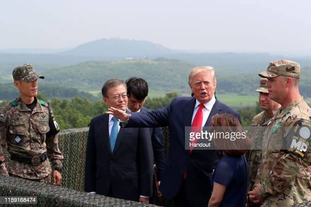 A handout photo provided by DongA Ilbo of US President Donald Trump attends with South Korean President Moon Jaein at the Observation Post Ouellette...