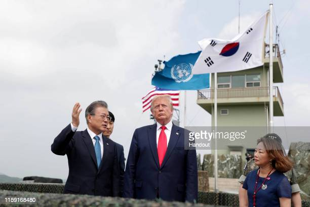 Handout photo provided by Dong-A Ilbo of U.S. President Donald Trump attends with South Korean President Moon Jae-in at the Observation Post...