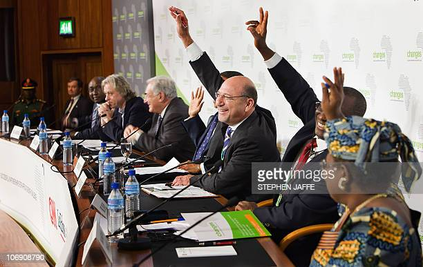 A handout photo provided by the International Monetary Fund shows some of the participants raising their hands in response to a question from left...