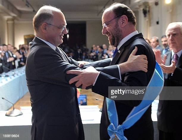 Handout photo released by the Argentinian Ministry of Foreign Affairs of Argentine Minister of Foreign Affairs Hector Timerman embracing his Chilean...