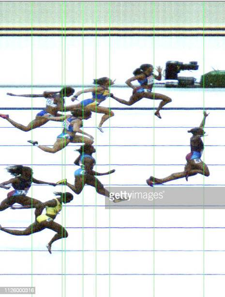 A handout photofinish image shows Kelli White of the US as she crosses the finish line first to win the women's 100m final first 24 August 2003 at...
