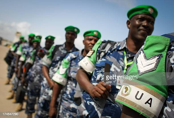 A handout photograph taken and released by the African UnionUnited Nations Information Support Team on July 27 shows Ugandan police officers...