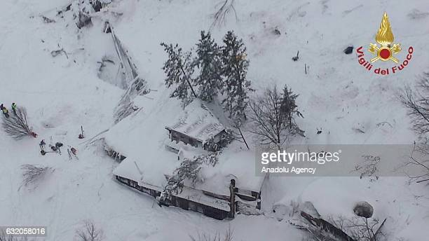 A handout picture provided by the Italian Fire Department shows an aerial view of hotel Rigopiano after it was hit by an avalanche in Farindola...