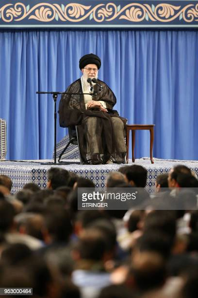 A handout picture provided by the office of Iran's Supreme Leader on April 30 shows Ayatollah Ali Khamenei delivering a speech during Labor Day at...