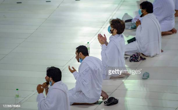 Handout picture provided by the Saudi Ministry of Hajj and Umrah on October 4 shows Saudis and foreign residents praying by the Kaaba in the Grand...