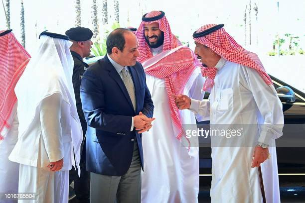 A handout picture released by the Egyptian Presidency on August 14 shows Saudi King Salman and Saudi Crown Prince Mohammed bin Salman receiving...